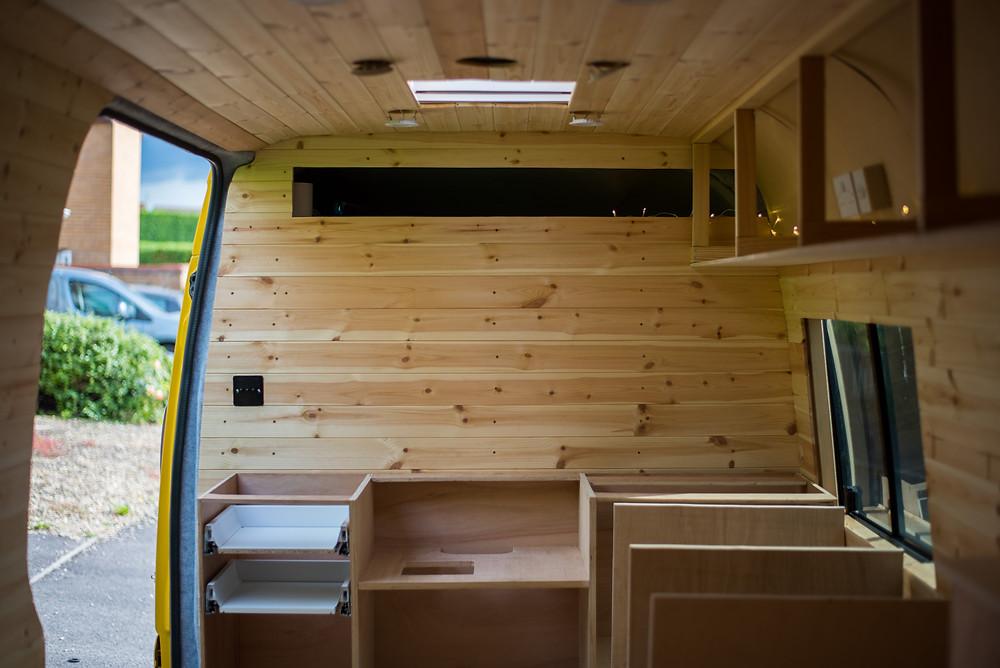 Kitchen carcass cabinets inside Sprinter camper van kitchen
