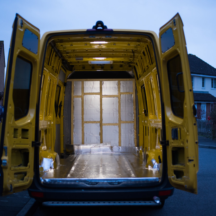 yellow Sprinter van conversion with insulation