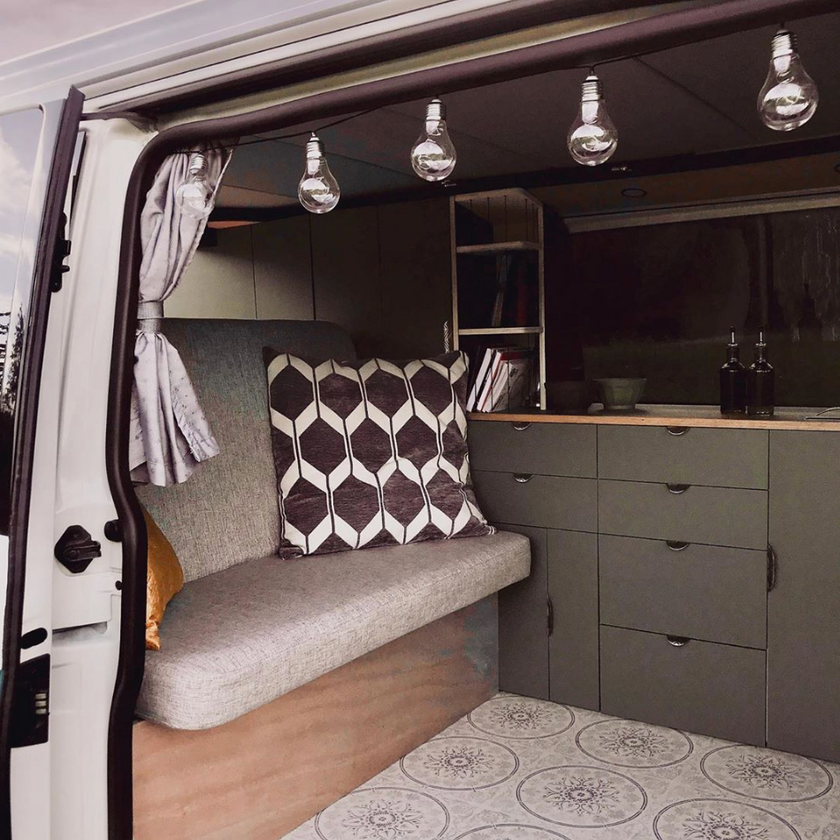 Beautiful kitchen and rock and roll bed in a VW Transporter T5 camper van conversion