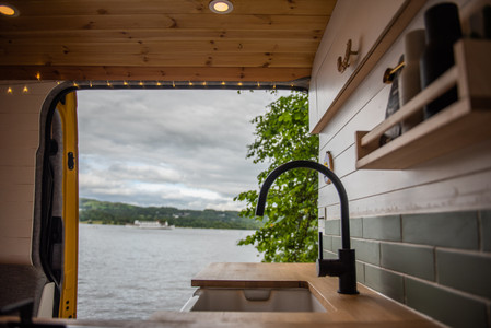 Camper van conversion with a belfast sink by Windermere in the Lake District