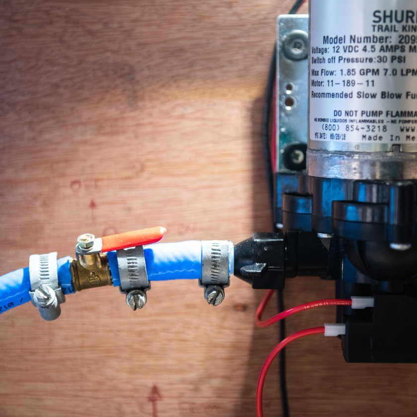Ball lever valve acting as an on off switch in a camper van water system going to a Shurflo water pump