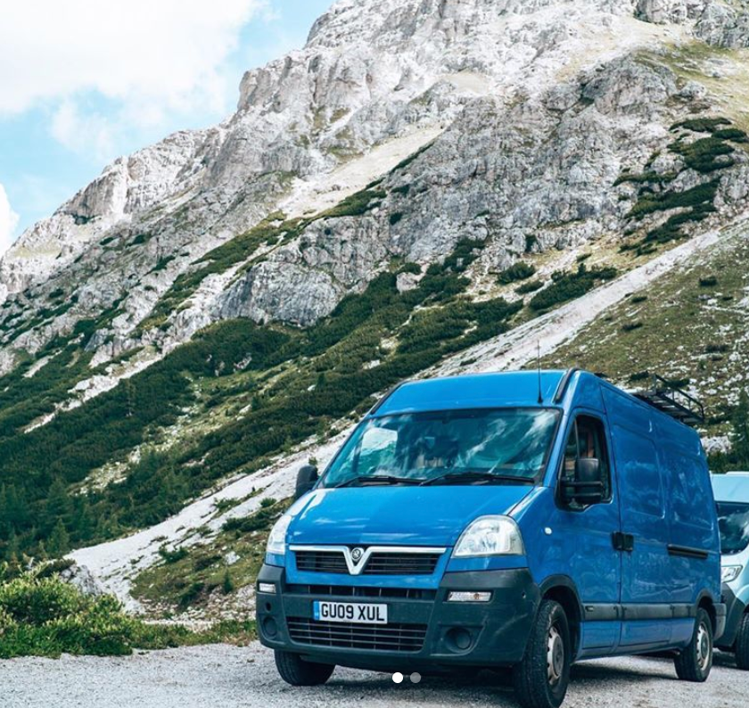 Blue Vauxhall Movano camper van conversion in the mountains