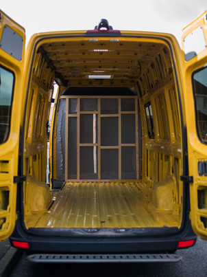 An empty ex DHL LWB Mercedes Sprinter, ready to be converted into a camper van