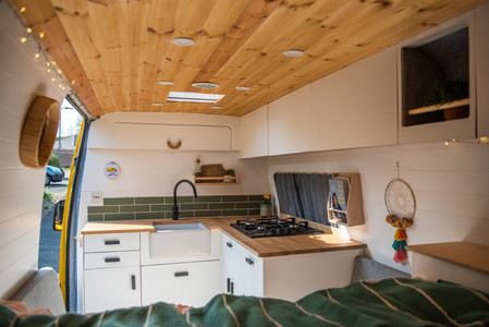 Beautiful kitchen in a camper van conversion with a belfast sink