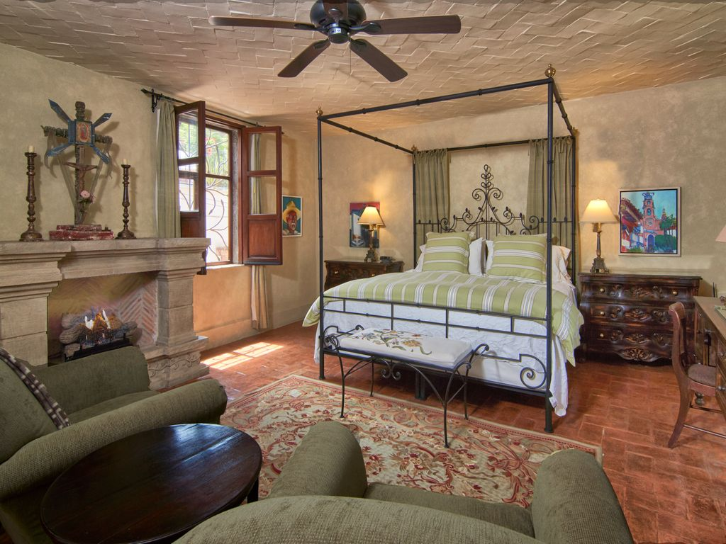 Casa Dos Cisnes master bedroom with fire