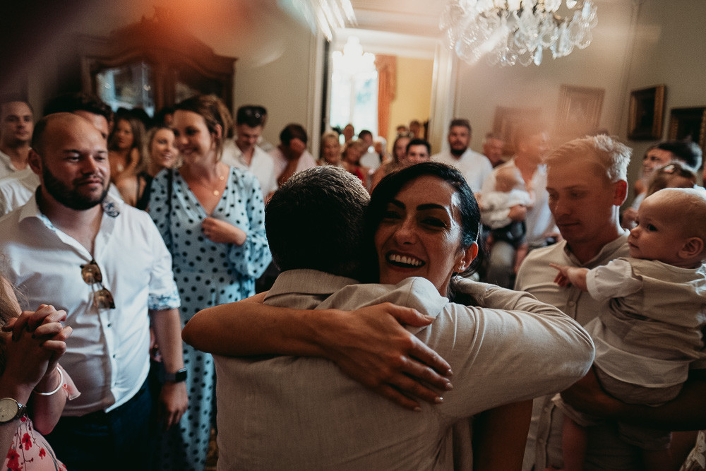 Candid photo of bride hugging her Dad at chic French wedding in Bordeaux