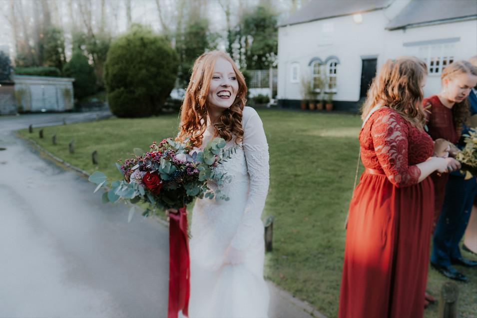 Creative wedding photographer: Smiling bride