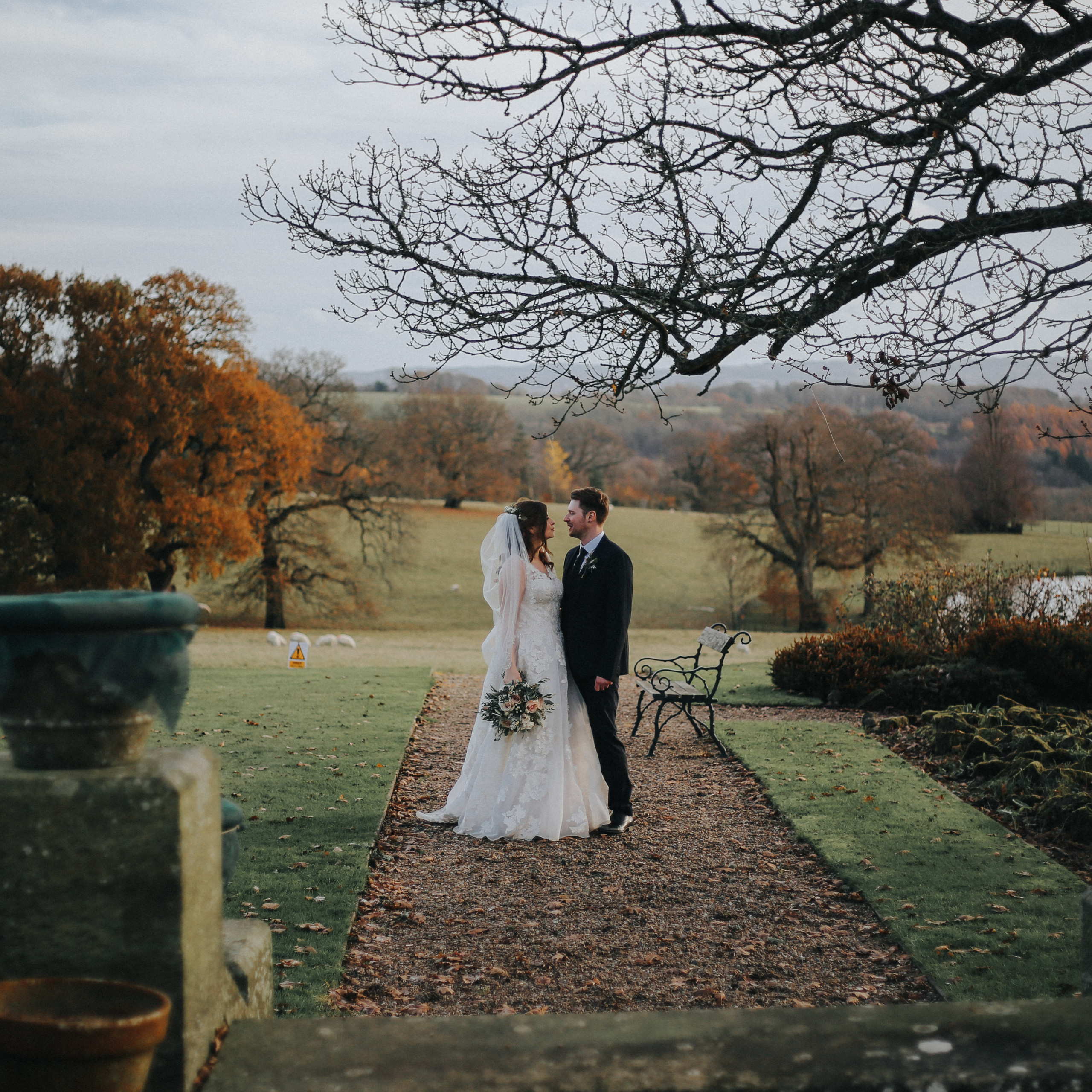 Bride and groom look into each others eyes at wedding at wadhurst castle
