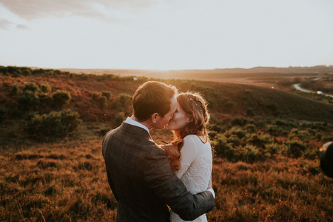 Creative wedding photography: Bride and groom and puppy in New Forest