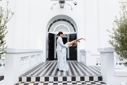 Fun Wedding photography: bride and groom outside Belair House