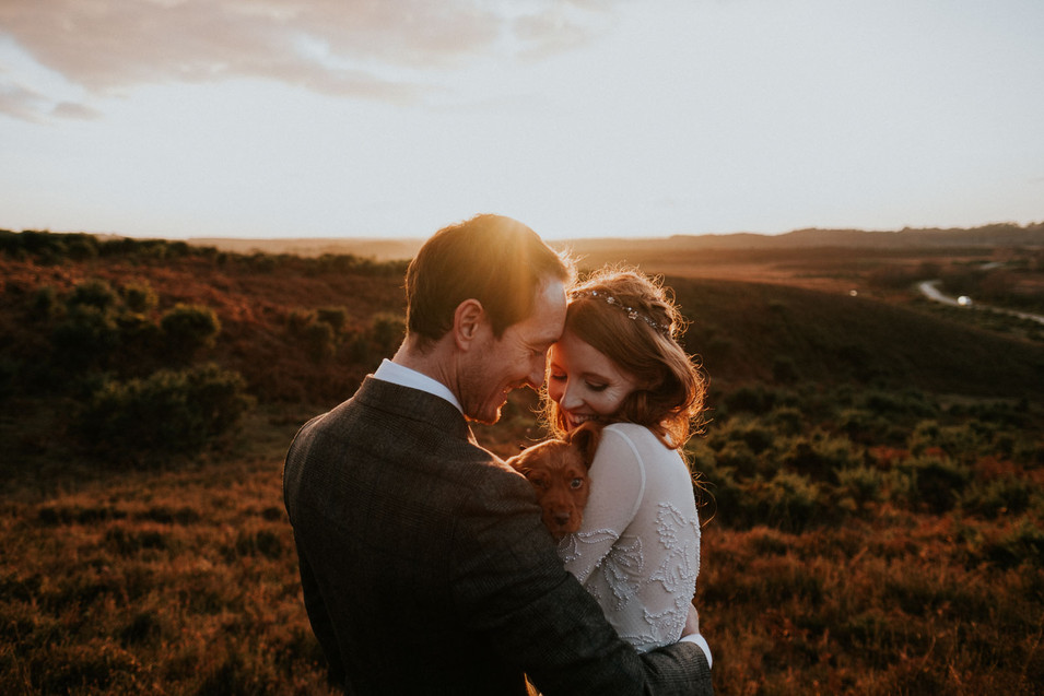 Boho wedding photography: Bride and groom and puppy in the New Forest