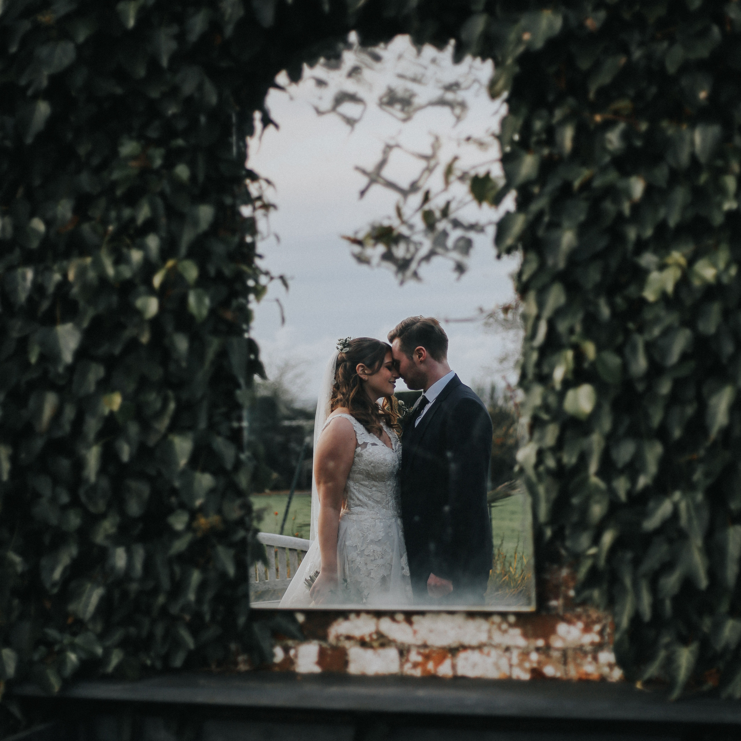 bride and groom photographed in garden mirror at wadhurst castle