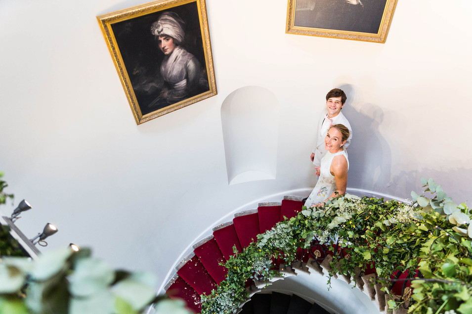 Documentary Wedding photographer: bride and groom on stairs at Belair House
