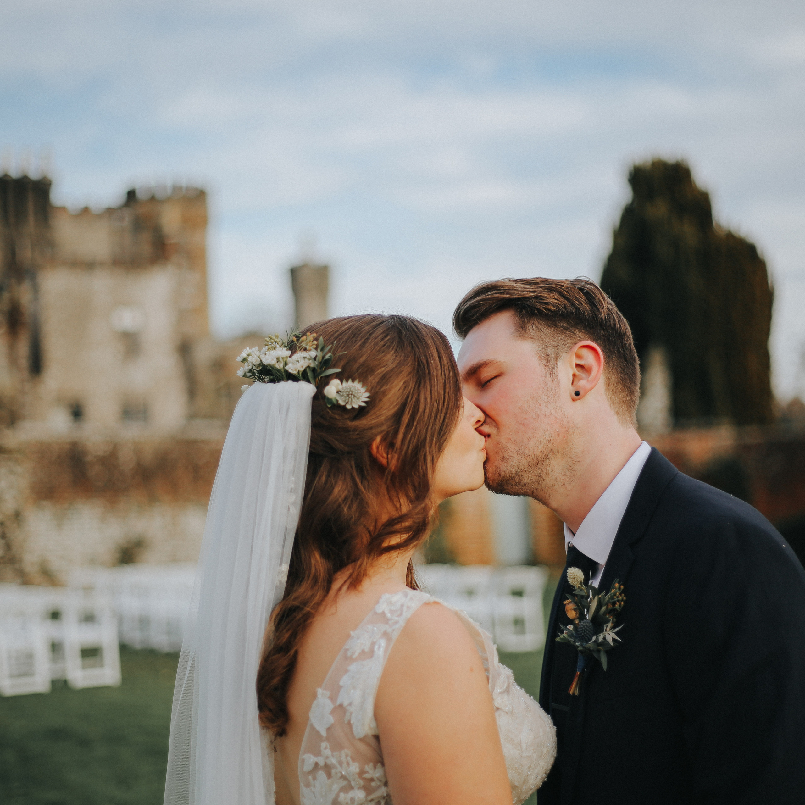 Bride and groom kiss at wedding at wadhurst castle