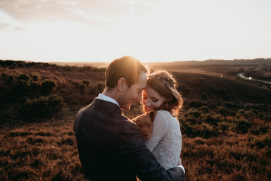 creative sunset photo of bride and groom