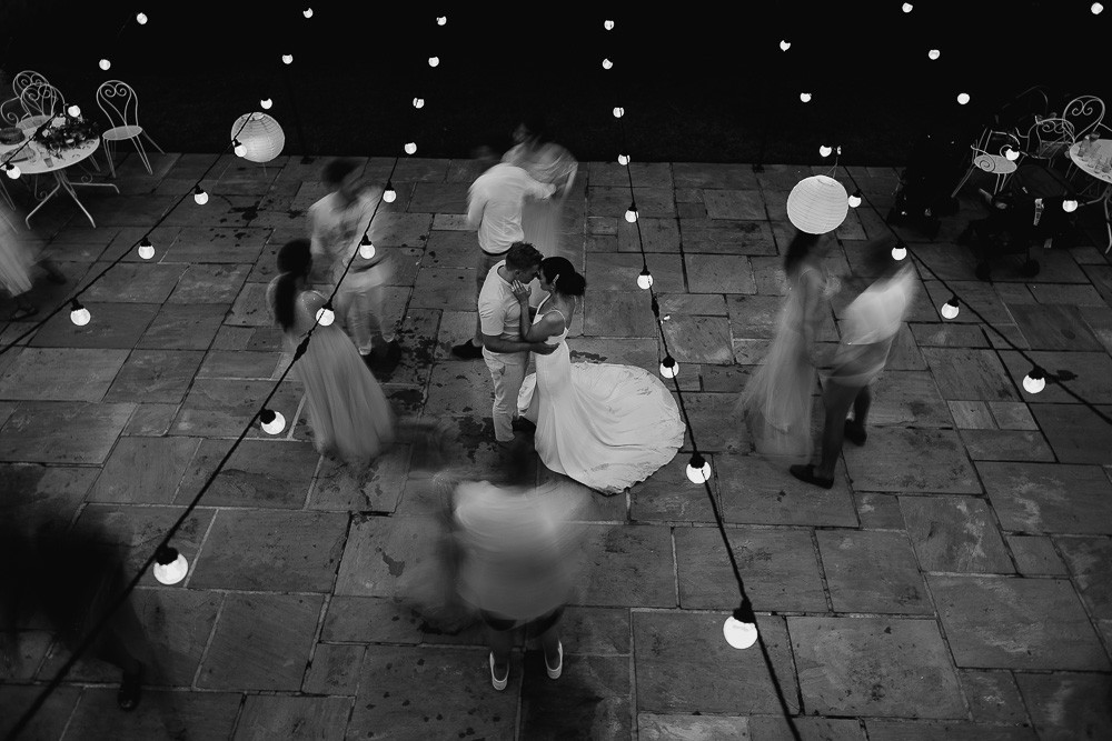 Black and white candid photo of the bride and grooms first dance, photographed from a birds eye view