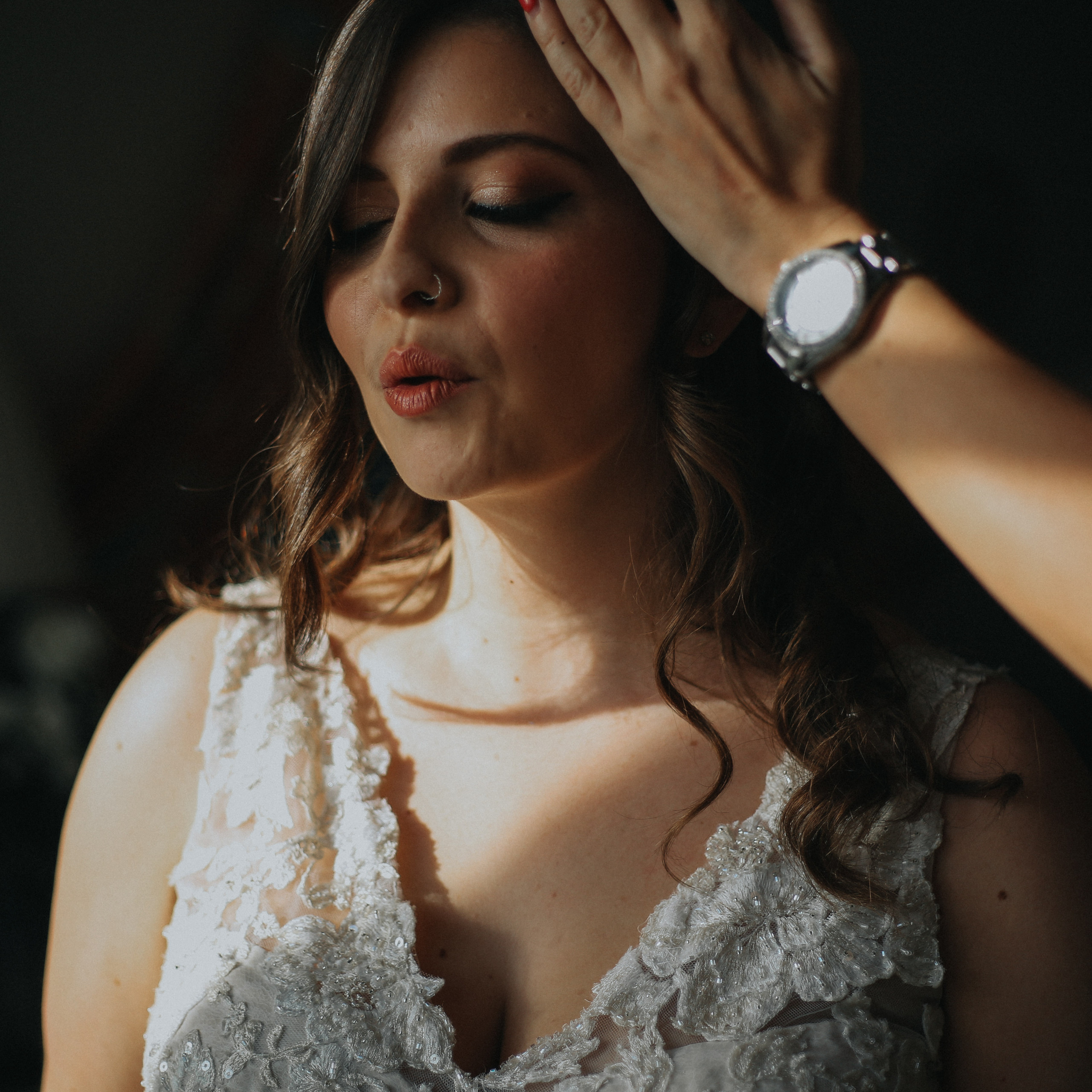 bride takes a final breath during final moments of bridal preparation at Wadhurst Castle