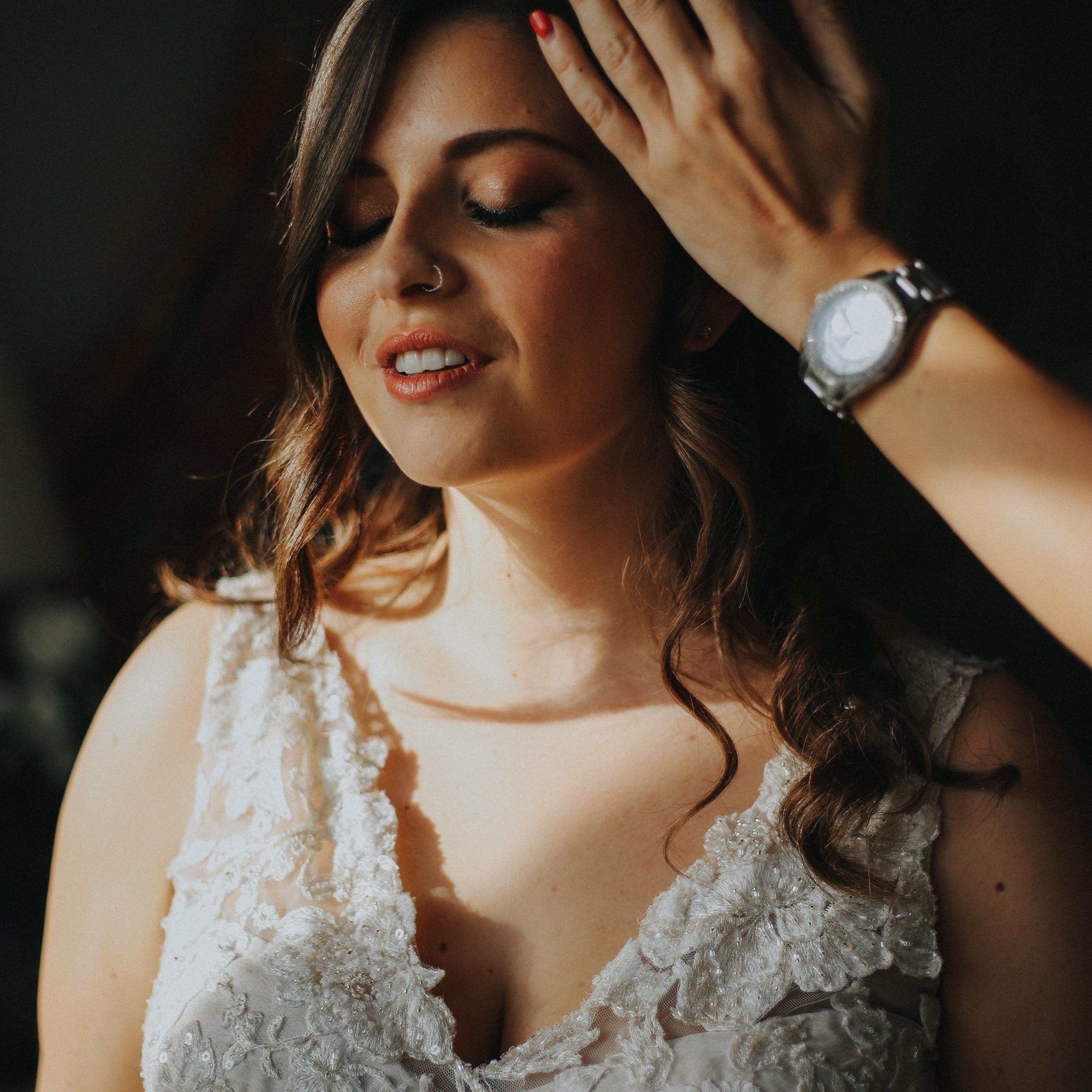 Portrait of bride at final moments of wedding preparation at Wadhurst Castle