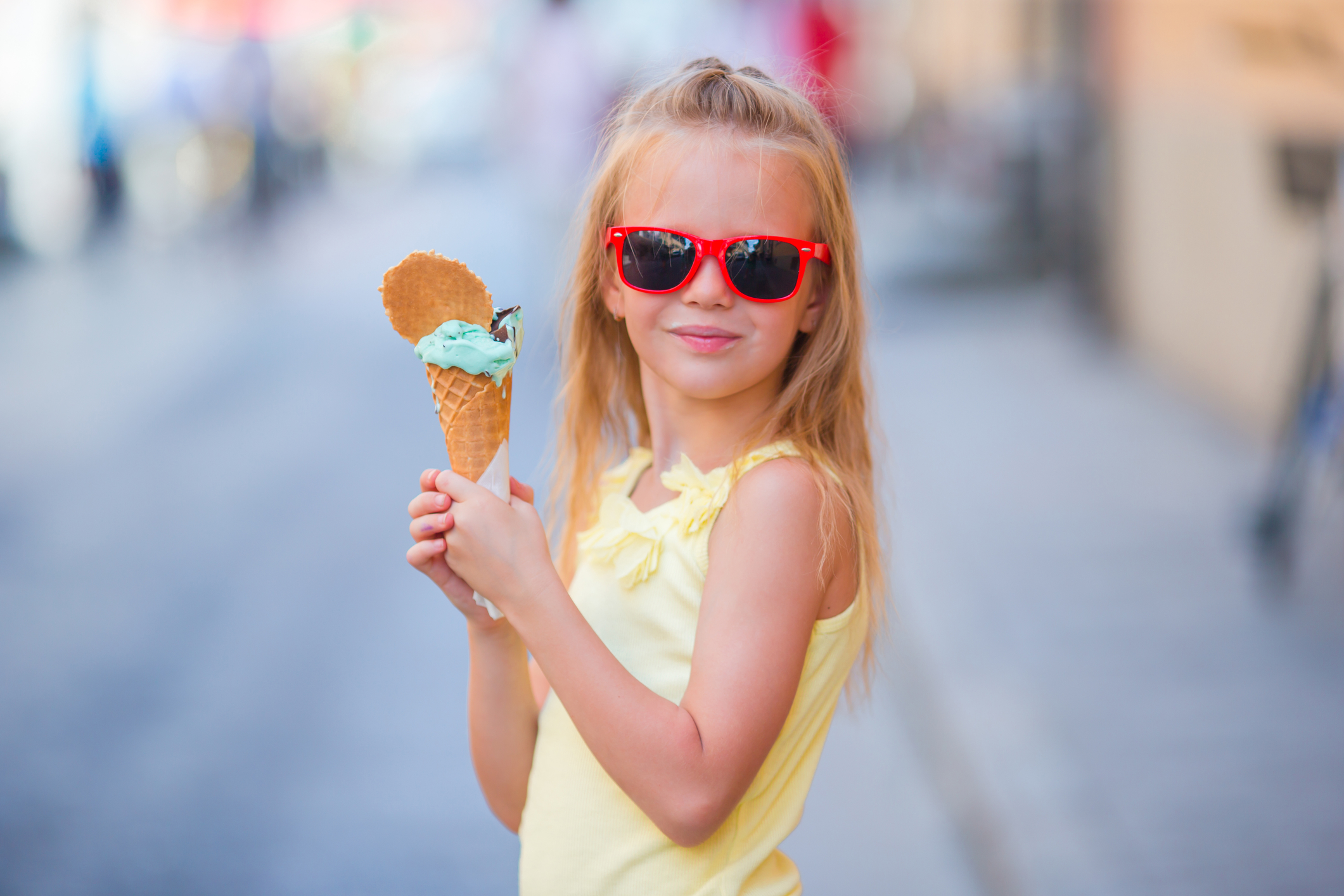 adorable-little-girl-eating-ice-cream-outdoors-at-summer-cute-kid-enjoying-real-italian-gelato-near-