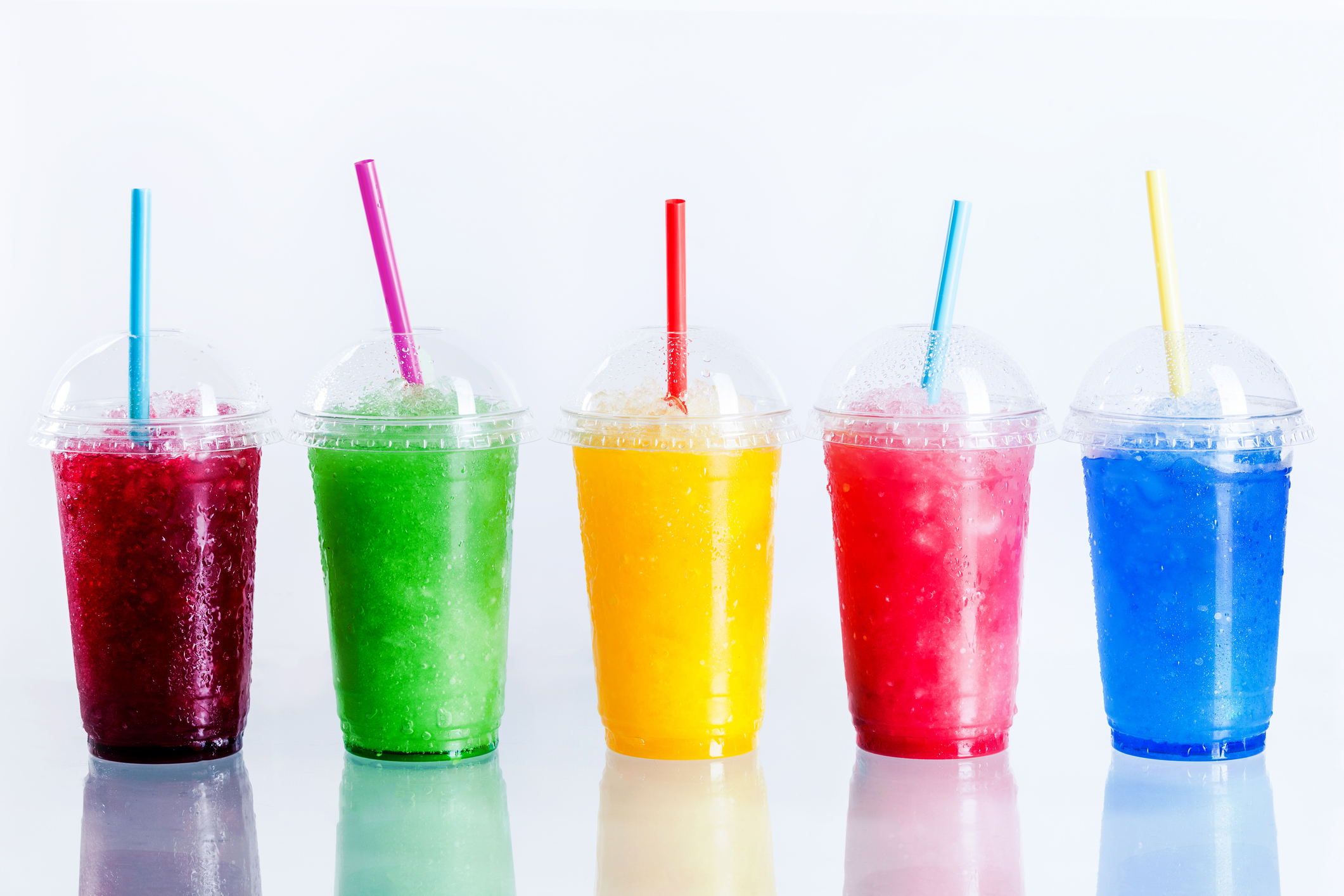 row-of-frozen-fruit-slushies-in-plastic-cups-69367710