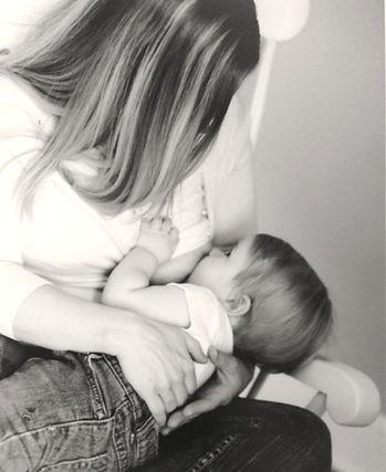 Mom breastfeeding baby.