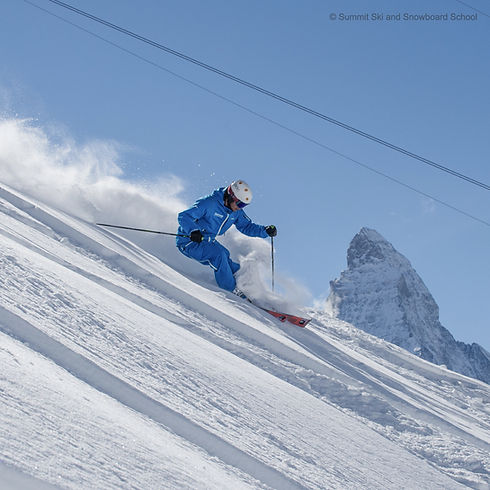 Powder skiing in front of the Matterhorn