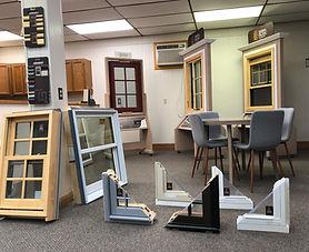 Oneonta Window & Door showroom with corner cross sections, casement, and double hung window displays