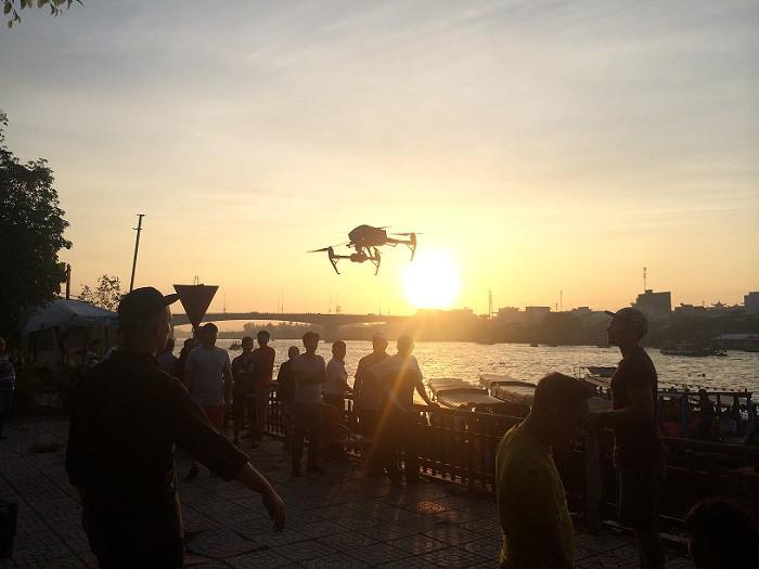 Flying drone at Cai rang floating market at dawn
