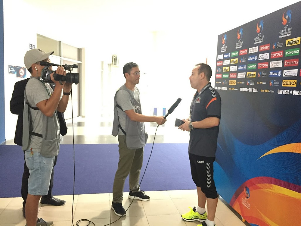 Andy Nguyen was interviewing coach of a futsal club before the match