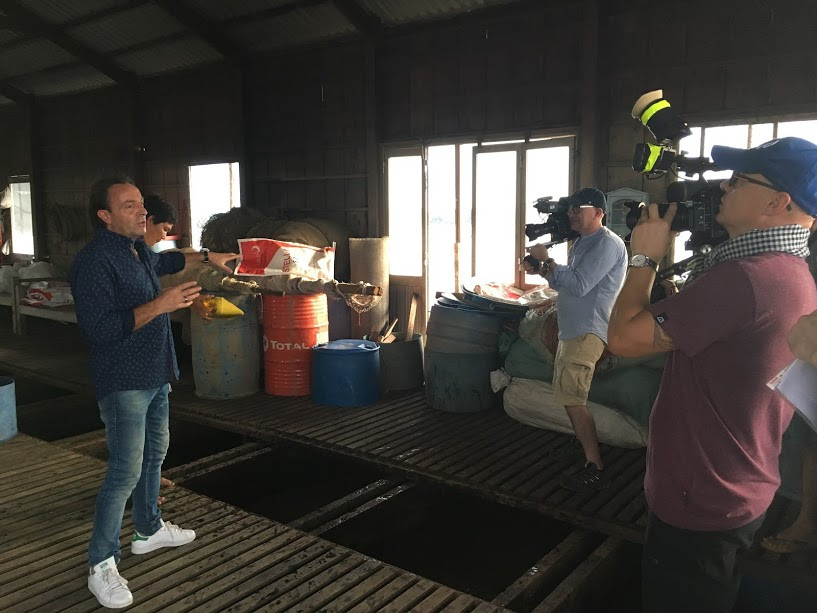 Filming in Vietnam and TVN crew at a fish farm in Can Tho, heart of Mekong delta