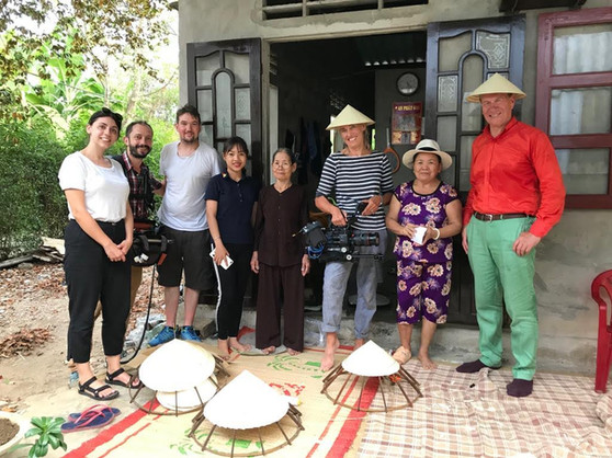 Fixer in Vietnam with a film crew from Boundless Productions at a conical hat village in Hue, Vietnam