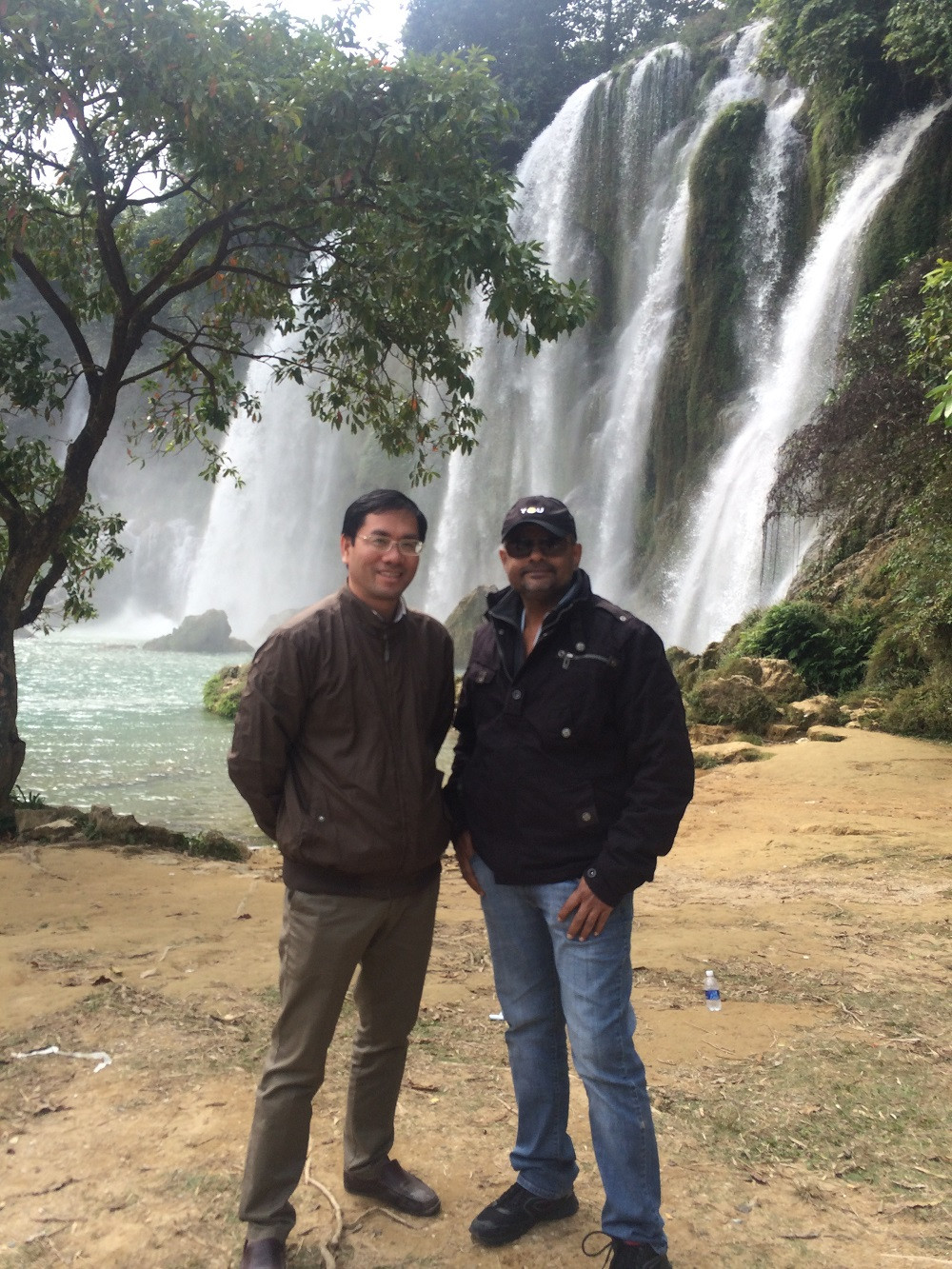 Fixer in Vietnam - Andy Nguyen and Director of Photography - Sabapathy Thirunavukkarasu stood in front of Ban Gioc subordinate waterfall.