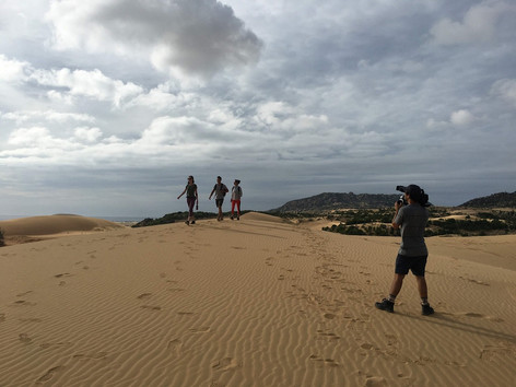 Filming in Vietnam with Eagle Creek film crew at a sand dune in Ninh Thuan