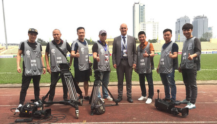 Filming in Vietnam team at Hang Day stadium before an AFC Cup football match.