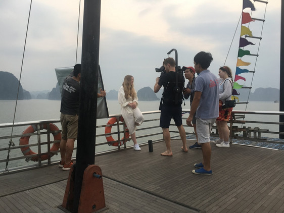 Vietnam fixer with film crew from Noir Productions in Ha Long bay