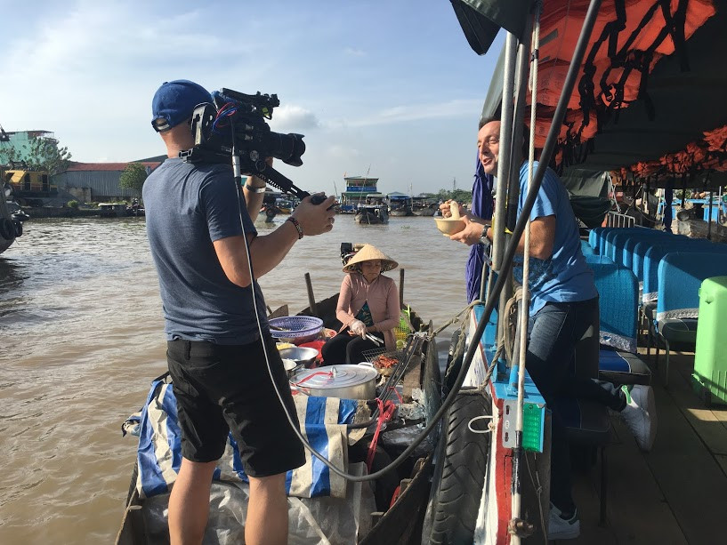 Filming in Vietnam accompanied TVN film crew to Cai Rang floating market in the Mekong delta to explore the trade on boats.
