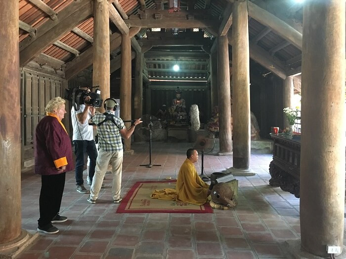 Filming in Vietnam with Media Lane film crew at a buddhist temple