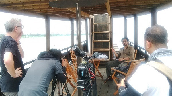 Fixer in Vietnam organised the shoot on a boat traveling along Mekong river in Cambodia for Channel NewsAsia crew.