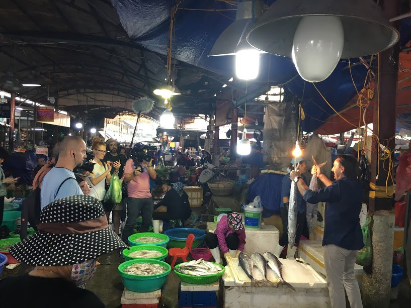 Filming in Vietnam and TVN film crew at a seafood market in Ha Long Bay
