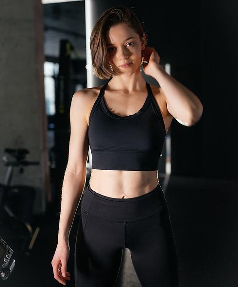 portrait-confident-healthy-brunette-woman-wearing-sportswear-standing-gym_edited.jpg