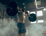 fit-young-man-lifting-barbells-working-o