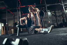 athletic-man-and-woman-with-dumbbells.jp