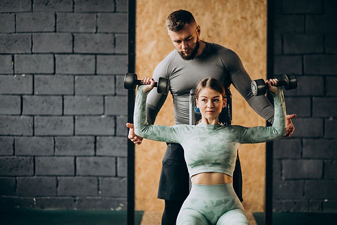 woman-doing-workout-gym-with-trainer.jpg