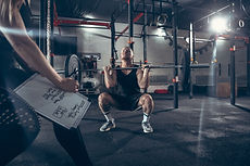 athletic-man-woman-with-dumbbells(1).jpg