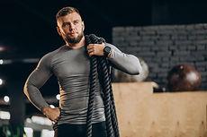handsome-man-exercising-gym.jpg