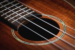 2-closeup-of-a-ukulele-guitar-with-strin