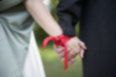 Hands tied with ribbon at traditonal han