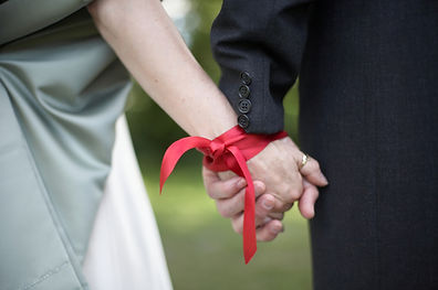 Hands tied with ribbon at traditonal han