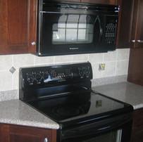 Kitchen-Dark-Cabinets1-1024x576.jpg