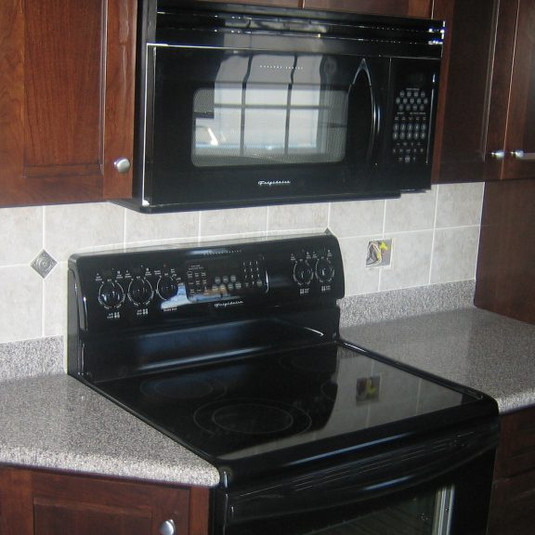 Kitchen-Dark-Cabinets1-1024x576.jpg